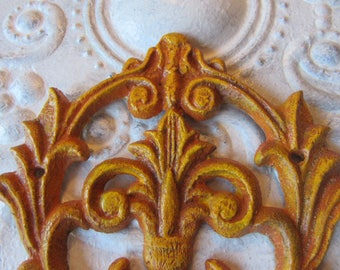 Architectural Wall Hook in Yellows and Oranges Antiqued Cast Iron Metal Wall Hanger Farmhouse Distressed Accent One of a Kind Ready Ship H-9
