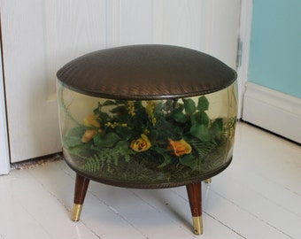 HOLD for Delores Inflatable terrarium footstool faux flowers kitsch