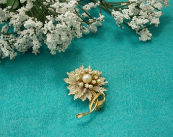 1950s White Flower brooch with aurora borealis stones