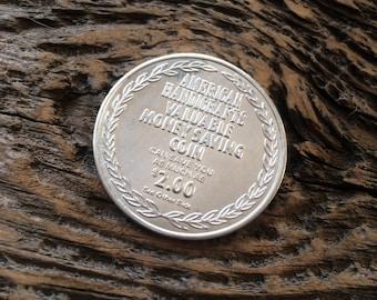 American Handicrafts coin 1960s  • Discount token • Valuable money saving coin
