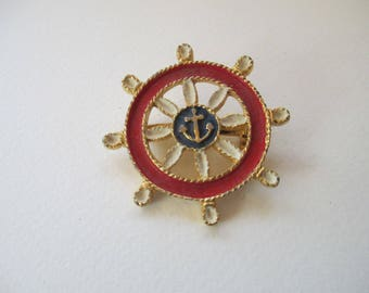 Vintage red and blue ships wheel with anchor gold tone metal backing no markings