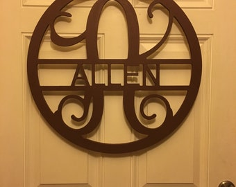 Hand painted wooden wall monogrammed.