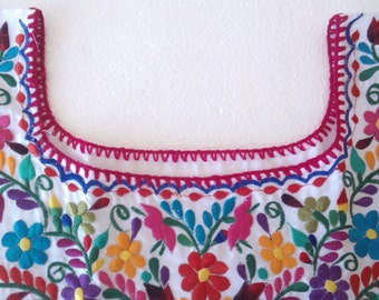 Crafty Chica made a purse from a Mexican embroidered blouse.