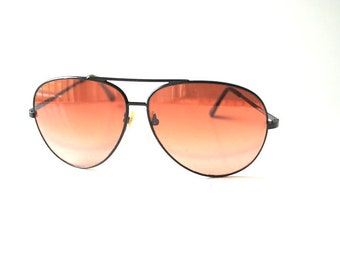 Vintage 80s,Serengeti, aviator, drivers, unisex sunglasses with a dark brown shades.Corning optics.
