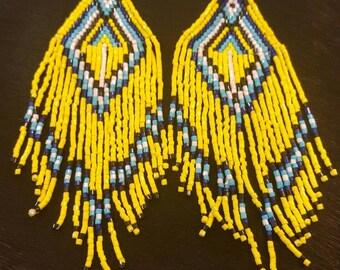 Wild flower shoulder dusters. Hard made seed bead earrings