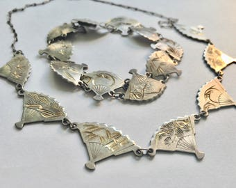 vintage Asian fans, a necklace and a bracelet in silver