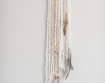 White yarn weaving wall hanging