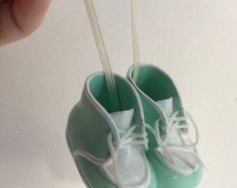 Vintage porcelain baby shoes hanging figurine. Porcelain baby shoes cake topper. Baby shoes car decor.