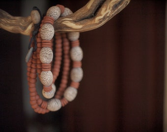 Doubled ceramic necklace with big craquelure beads and binding terracotta little beads