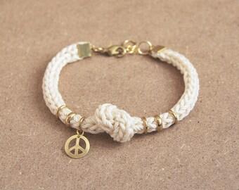 Peace bracelet, rope bracelet with knot, knit cord bracelet with peace charm, cream bracelet
