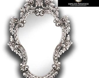 Spectacular Colonial mirror in silver bread