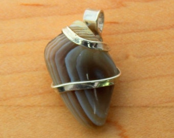 Pendant in Agate with Solid Sterling Silver hand forged unique setting.