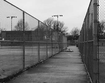 Original black and white photograph of abandoned tennis courts in winter. Chain link fence. Deserted. Picture is customizable. Great gift.