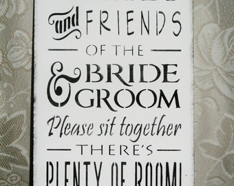 Family and friends of the bride and groom please sit together there's plenty of room, wedding sign, open seating, wood, black and white,