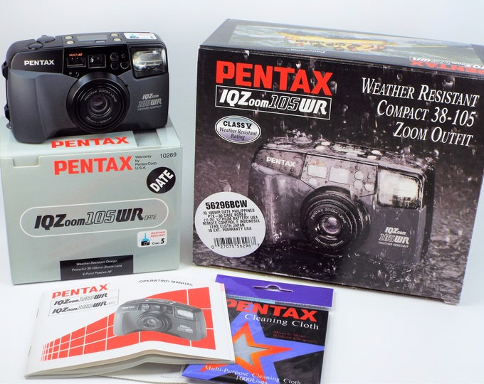 Mint New in Box Pentax IQ Zoom 105WR Date 35mm Camera Set - Weather Resistant w/38-105mm Pentax Power Zoom Lens, Case, Strap, Batteries