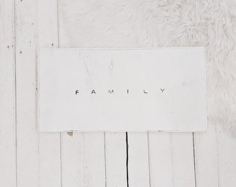 family black and white wood sign