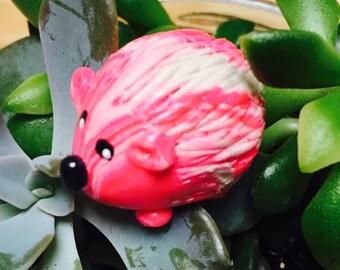 Mini marble Hedgehog of Hedgehog Bog shown in hot pink and white swirl
