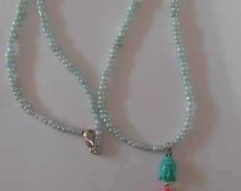 Mint green glass beads boho ibiza necklace with a green acryl buddha charm and pink tassel