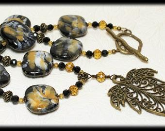 Autumn... Handmade Jewelry Necklace Beaded Statement Piece Glass Slabs Crystal Antique Brass Leaf Pendant Black White Tangerine Orange Amber