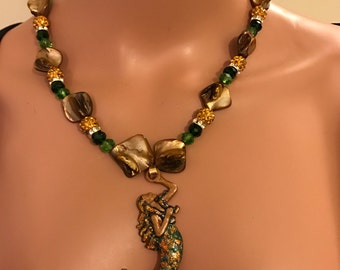 Brunette black mermaid w gold , copper, green necklace