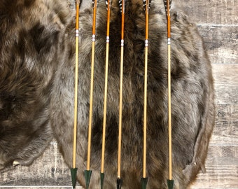 "Hand made port orford cedar hunting arrows.  30"" from tip of nock to the top of the broadheads.  45-50 lb spine weight.  125 grain broadhead"