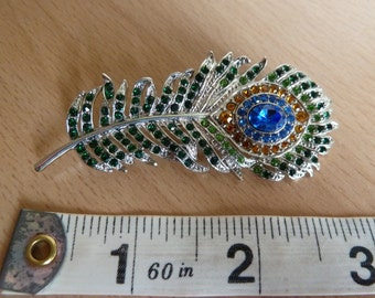 Vintage Blue and green diamante feather brooch. Blue and green crystal brooch. Feather crystal brooch. Vintage blue green feather brooch.