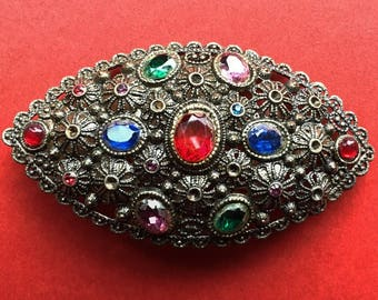 Beautiful Antique brooch- signed New England Glass Works- glass faceted stones in a metal filligree setting in a folliage/floral design