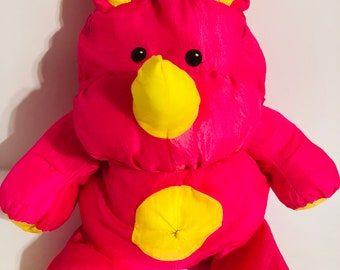Vintage Fisher Price pink rhino puffalump with yellow belly stuffed toy plush