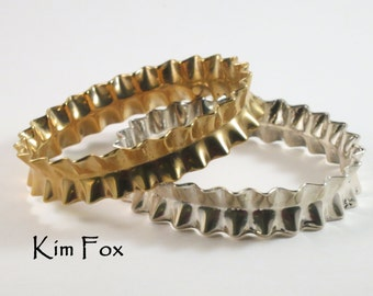 9 inch Ruffle Bangle in Golden Bronze or Sterling Silver made to wear alone or with others. Oval in shape for comfort.