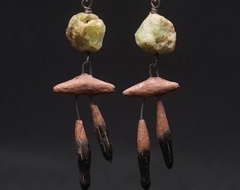 Apache Moon earrings, rustic ceramic glyphs dangle below rough peridot Apache moons.  Green moons in a silent sky, October moons.