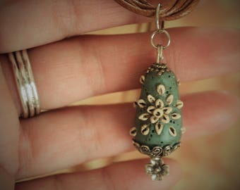 One Of A Kind ~ Hand Carved Clay Charm on faux leather multi-strand cord with silver embellishments.