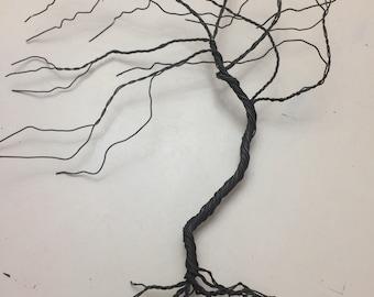 Steel wire wind swept tree