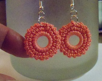 Small crocheted earrings in coral