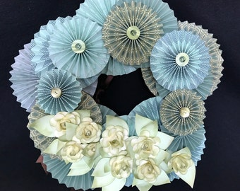 pastel greens and blue paper rosette wreath with pastel green roses