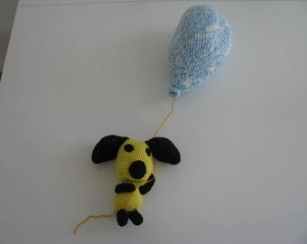 Dog hanging from his balloon to crochet