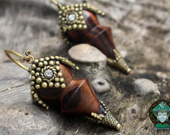 WOODEN TRIBAL EARINGS, brass, wood, handcarved, brass detailes, ornate.