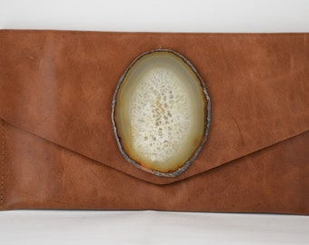 handmade copper cow leather envelope style clutch with a gold oval geode crystal