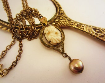 Very old vintage cameo, upcycled, handmade necklace. Single genuine bronze dyed pearl drop. Upcycled gold-toned chain. White cameo, classic.