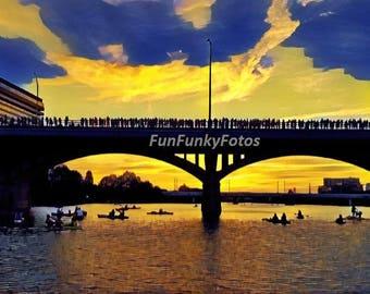 Color photograph of the Congress Avenue bridge at sunset