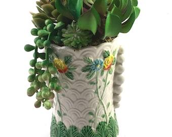 Faux succulent plant arrangement in tall vintage ceramic planter vase with raised textural floral & leaf design marked Made in Japan