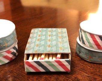 Gift set of four decorated tea lights and matchbox