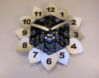 Wall clock 'black sunflower' with specific tetra pak recycled