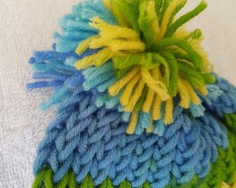 Hand crocheted child's pompom hat