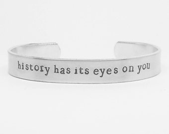 History has its eyes on you  : Hand Stamped Aluminum Hamilton Musical quote cuff by fandomonium