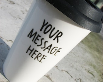 Personalized travel mug with custom message in hand-lettered sans serif font
