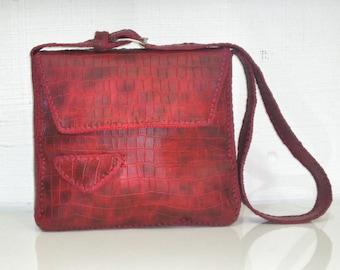 Red crocodile bag