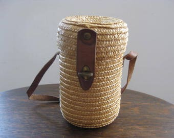 Vintage French high glass in wicker bag from the spa town of Brides les Bains.