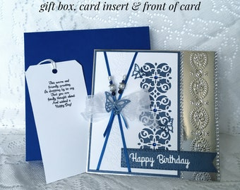 Birthday Card in royal blue, white and silver with stick pins, die cuts. embossing, ribbon and butterflies.