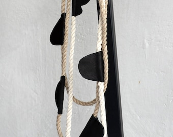Layered statement rope necklace.