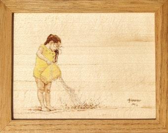 Girl Dumping a Bucket on the Beach Woodburning Art